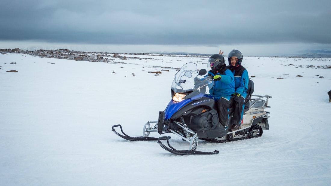 two people on a snowmobile on the Golden Circle snowmobile tour with When in Iceland